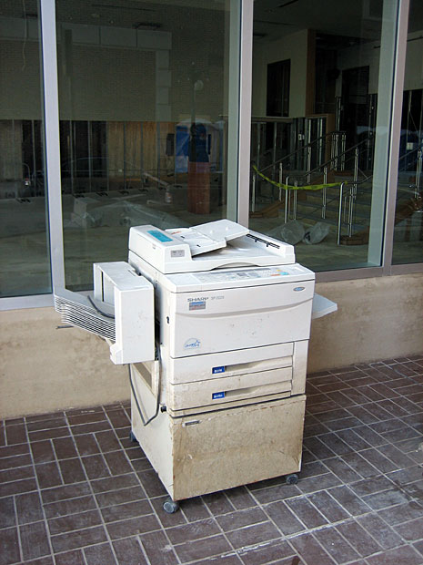 October 2005: Flooded office machinery set out on curb, Central Business District, New Orleans, after Hurricane Katrina.