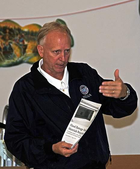 On November 15, 2008, National Flood Insurance Program (NFIP) Lead Wayne Berggren outlined the NFIP program and explained helpful resources available to residents affected by flooding at a community meeting on Flood Proofing and Elevation Information in Jean Lafitte, Louisiana.