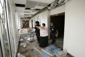 FEMA Public Assistance Specialists Sheila Luster and and William Ciarelli inspect the Starr County Memorial Hospital with administrator Thalia Munoz to determine if the county will be eligible for federal assistance to offset expenses caused by the recent flooding.